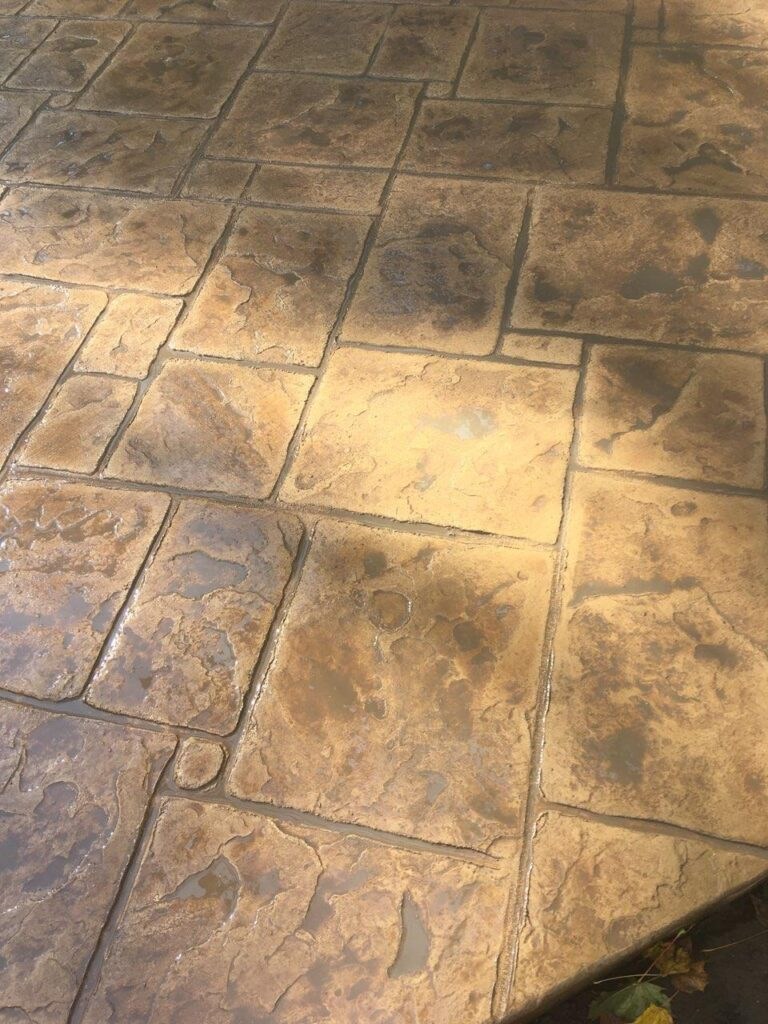 Finished concrete patio showing up-close stone details