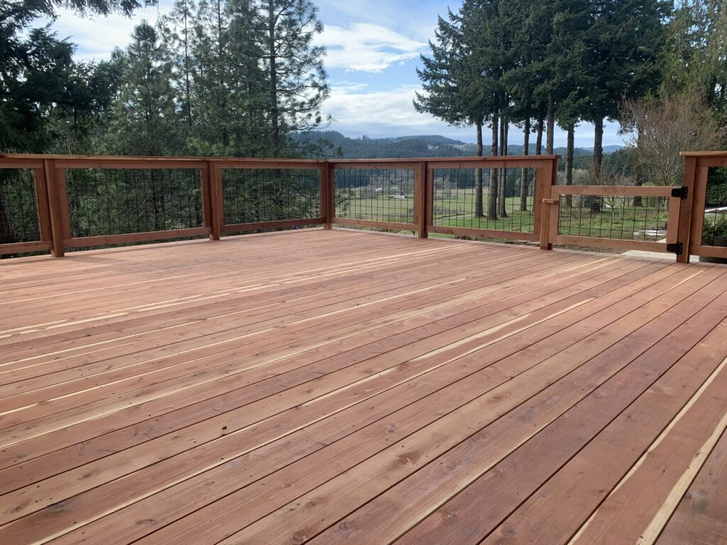 Wooden fenced deck facing out towards the mountains